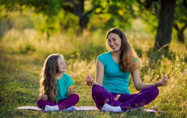 Try this Parent/Child Partner Yoga Sequence to Strengthen the Ties that Bond